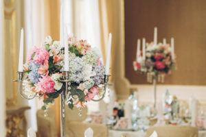 Colorful and elegant floral bouquet on top of a silver candelabra